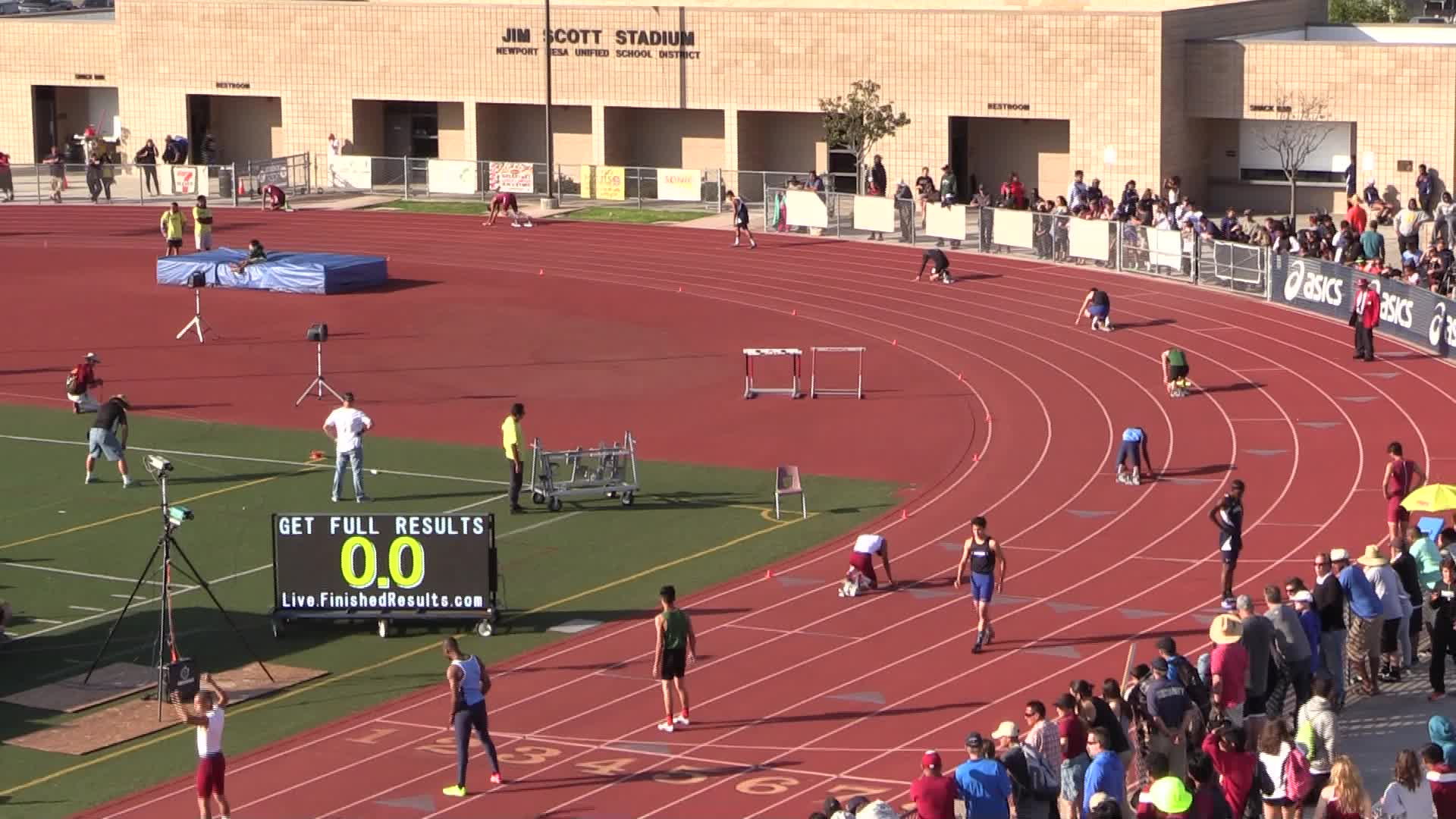 Image:  Catalina Foothills High School track with athletes performing events